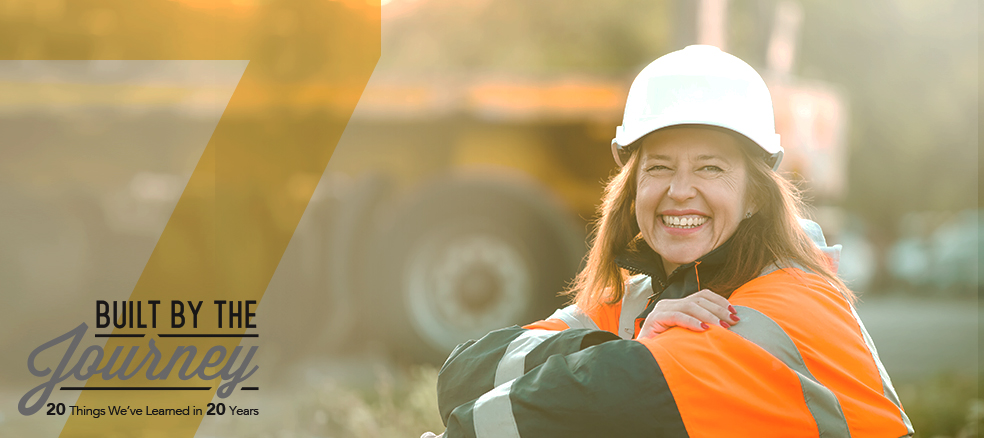 woman construction worker smiles