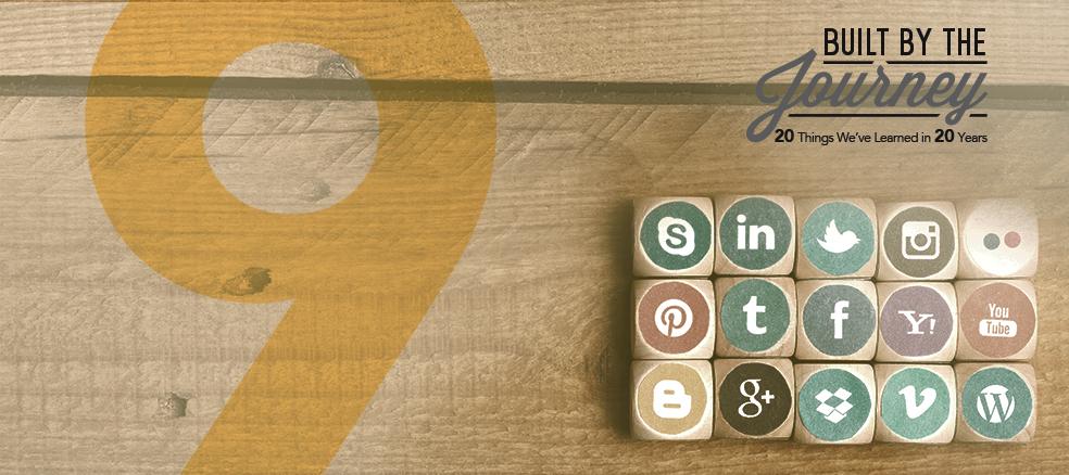 skype, linkedin, twitter, instagram, flickr, pinterest, tumbler, facebook, yahoo, youtube, blogspot, google+dropbox, vimeo, and wordpress logos on wooden blocks with a wooden background